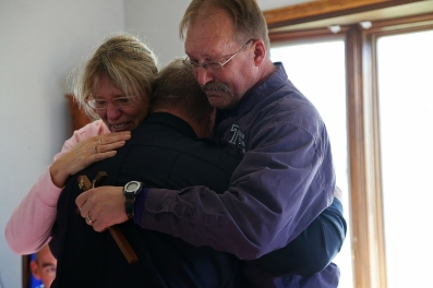 Jayne and Randy Martin, parents of Urbandale Police Officer Justin Martin, hug Police Chief Ross McCarty who traveled to Rockwell City to meet with the family on Thursday, Nov. 3, 2016, the day after Martin was shot and killed while on duty.