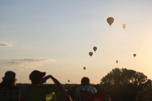 Hot air balloons float through the air during the National Balloon Classic in Indianola on July 29, 2015.