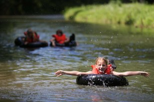 Campers float down Bear Creek on July 21, 2015 during Camptastic at Camp Tahigwa. Instead of a swimming pool, Girl Scouts attending camp at Tahigwa get to swim and play in the creek.