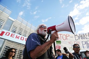 Frank Cordaro, of Des Moines speaks to the crowd during the Stop the Bakken Pipeline Rally and Speak Out on Thursday, Oct. 15, 2015 outside the Iowa Utilities Board Office in Des Moines.