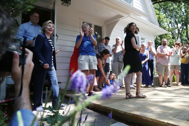 Presidential hopeful Hillary Clinton makes her entrance to Sean Bagniewski and Vidhya Reddy's backyard for a campaign event on Saturday, July 25, 2015 in Beaverdale.