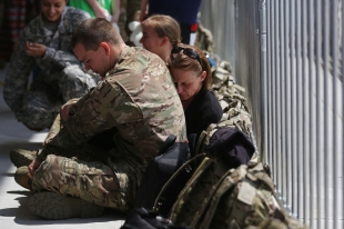 Debbie Klein spends some time with her son Jacob Klein during a send off ceremony for the 185th Combat Sustainment Support Battalion of the Iowa Army National Guard on Sunday, May 8, 2016, at the Iowa National Guard's Des Moines Airbase. Debbie's son Jacob and her daughter Cheryl were both deployed today.