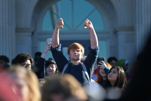 A student at Roosevelt High School holds up two thumbs down during a walkout to protest Donald Trump's presidential election victory on Wednesday, Nov. 9, 2016, in Des Moines. Similar protests were organized at high schools across the metro.