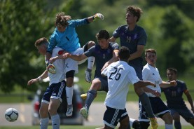 Norwalk and Xavier players get caught in traffic in front of the goal during the class 2A state soccer championship game against Norwalk and Xavier. Norwalk won the match 2-1.