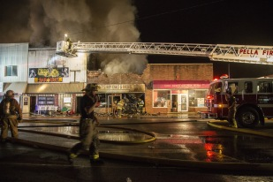 Firefighters battle a 15-alarm fire in the Melcher-Dallas city square on Tuesday night, July 4, 2017. The fire started around 9:30 p.m. and the cause is still under investigation.