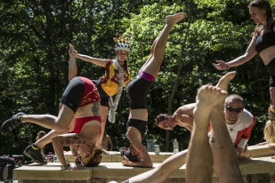 A team of RAGBRAI riders do yoga poses on a bridge at Dunnings Spring Park in Decorah, on Friday, July 28, 2017, on the sixth day of the ride in northeast Iowa.