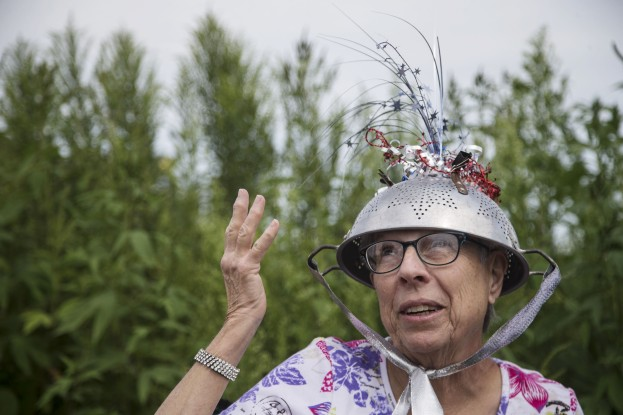 Barb Lamb, of Hamburg, wears a colander hat as a joke, to keep the aliens from reading her mind, during the eclipse on Monday, Aug. 21, 2017, at the Lower Hamburg Bend Wildlife Management Area in the far south west corner of Iowa, the only part of the state to be in the path of the total eclipse.