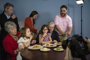 The Branstad family is filmed while eating mooncakes for a Mid-Autumn Festival video greeting filmed by members of the US Embassy staff on Sunday, September 24, 2017, at the Ambassador's Residence in Beijing, China. Mooncakes are traditionally used to celebrate the holiday which fell on Oct. 4 this year.