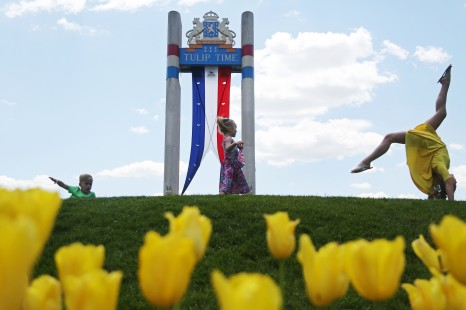 Siblings, Cohen Beer, 6, Ivy Beer, 4, and Kenley Beer, 9, of Iowa Falls, play among the blooming tulips during Tulip Time on Thursday, May 4, 2017, in Pella.