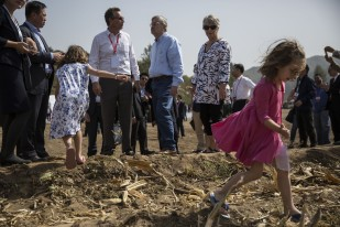 Ambassador Terry Branstad's granddaughters Stella, in the foreground, and Sofia Costa play at the edge of a corn field during the groundbreaking ceremony for the China-US Demonstration Farm on Saturday, Sept. 23, 2017, in Luanping County, Hebei, China.