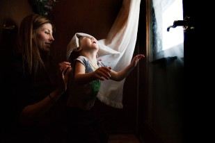 Tatum Woods, 4 of Vinton, plays in a window curtain while working on standing and walking with his physical therapist Emily Tiedtke in his home on Tuesday, Jan. 30, 2018, in Vinton. Woods has a rare genetic disorder known as Kabuki syndrome which leaves him unable to walk without assistance.