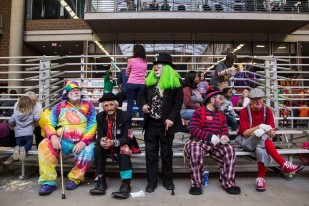 A row of clowns sit together during the Za-Ga-Zig Shrine Circus on Sunday, Jan. 28, 2018, at the Iowa State Fairgrounds in Des Moines.