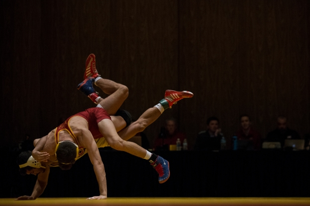 Iowa State's Jarrett Degen and Rider's Gary Dinmore wrestle at 149 on Sunday, Nov. 26, 2017, in Stephens Auditorium on the Iowa State campus. Degen won the match 5-2.