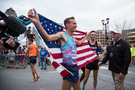 Riley Masters celebrates after winning the 2018 USATF 1 Mile Road Championship during the Drake Relay's Grand Blue Mile on Tuesday, April 24, 2018, in downtown Des Moines.