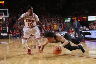 Iowa State's Lindell Wigginton trips after Northern Illinois' Eugene German commits a foul during the men's basketball game against Northern Illinois on Monday, Dec. 4, 2017, in Hilton Coliseum. The Cyclones beat the Huskies 94-80.